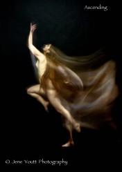 nude female leaping upward